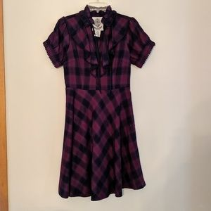 Purple plaid fit and flare dress.